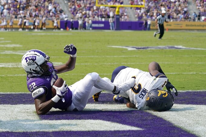 TCU wide receiver Blair Conwright (22) reaches the end zone after catching a pass for a touchdown as California safety Elijah Hicks (3) defends in the first half of an NCAA college football game in Fort Worth, Texas, Saturday, Sept. 11, 2021. (AP Photo/Tony Gutierrez)