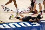 Missouri guard Drew Buggs reacts after fouling Oklahoma guard Elijah Harkless, rear, during the second half of a first-round game in the NCAA men's college basketball tournament at Lucas Oil Stadium, Saturday, March 20, 2021, in Indianapolis. (AP Photo/Darron Cummings)