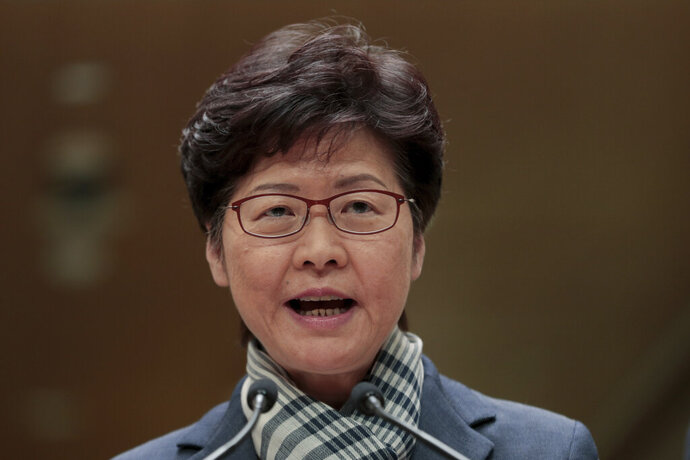 Hong Kong Chief Executive Carrie Lam speaks during a press conference in Hong Kong, Monday, Nov. 11, 2019. A protester was shot by police Monday in a dramatic scene caught on video as demonstrators blocked train lines and roads in a day of spiraling violence fueled by demands for democratic reforms. (AP Photo/Dita Alangkara)