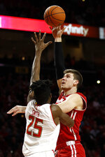 Wisconsin forward Ethan Happ, right, shoots over Maryland forward Jalen Smith in the first half of an NCAA college basketball game, Monday, Jan. 14, 2019, in College Park, Md. (AP Photo/Patrick Semansky)