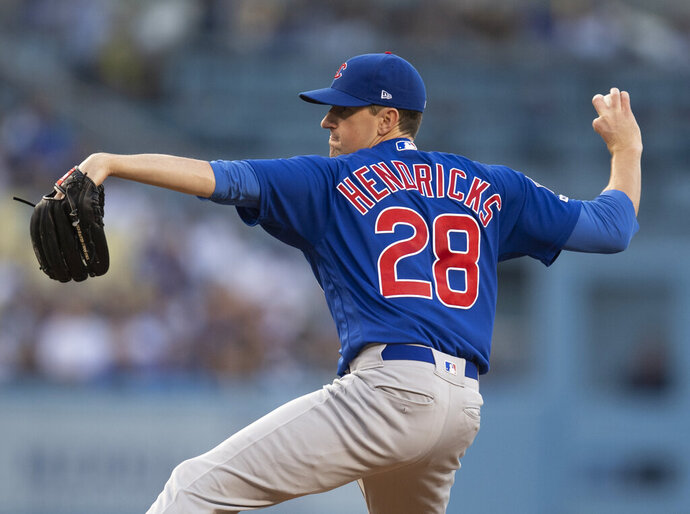 Chicago Cubs starting pitcher Kyle Hendricks throws during the first inning of the team's baseball game against the Los Angeles Dodgers in Los Angeles, Friday, June 14, 2019. (AP Photo/Kyusung Gong)