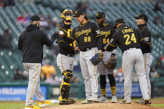 Pittsburgh Pirates manager Derek Shelton takes the ball from pitcher Miguel Yajure in the fifth inning during the second game of a doubleheader baseball game in Detroit, Wednesday, April 21, 2021. (AP Photo/Paul Sancya)
