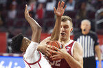 Stanford forward Lukas Kisunas, right, and Southern California guard Tahj Eaddy battle for the ball during the first half of an NCAA college basketball game Wednesday, March 3, 2021 in Los Angeles. (AP Photo/Kyusung Gong)