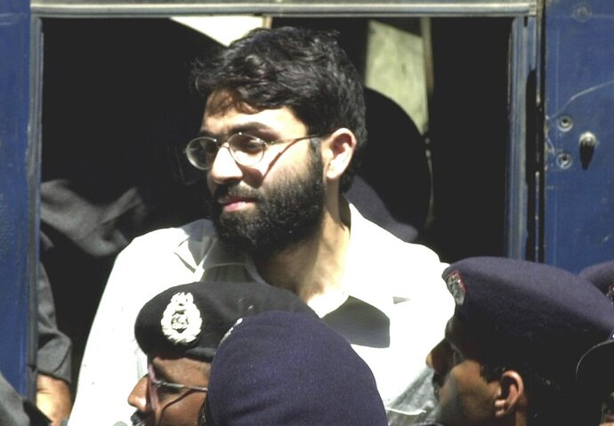 FILE - In this March 29, 2002, file photo, Ahmed Omar Saeed Sheikh arrives at a court in Karachi, Pakistan. A ruling by Pakistan's Supreme Court on Monday, June 29, 2020 paves the way for the man convicted of involvement in the gruesome 2002 murder of American journalist Daniel Pearl to walk free later this week.  (AP Photo/Zia Mazhar, file)