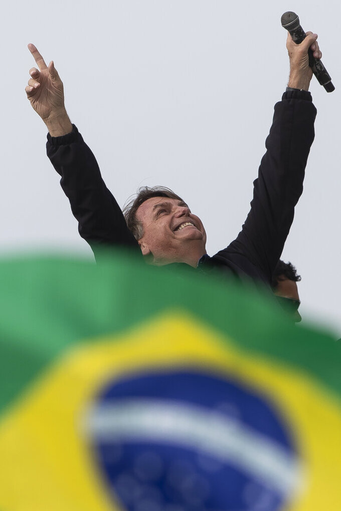 Brazil's President Jair Bolsoanro smiles after a motorcycle tour with supporters,in Rio de Janeiro, Brazil, Sunday, May 23, 2021. (AP Photo/Bruna Prado)