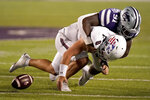 Southern Illinois quarterback Nic Baker (8) funnels the ball as he is tackled by Kansas State defensive end Felix Anudike (91) during the second half of an NCAA college football game, Saturday, Sept. 11, 2021, in Manhattan, Kan. Kansas State won 31-23 (AP Photo/Charlie Riedel)