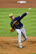Milwaukee Brewers starting pitcher Eric Lauer throws the ball during the third inning of a baseball game against the Philadelphia Phillies, Tuesday, May 4, 2021, in Philadelphia. (AP Photo/Derik Hamilton)