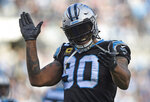 FILE - In this Dec. 24, 2017, file photo, Carolina Panthers' Julius Peppers (90) reacts to a play against the Tampa Bay Buccaneers during the second half of an NFL football game in Charlotte, N.C. Peppers announced his retirement, Friday, Feb. 1, 2019, after 17 NFL seasons, nine Pro Bowl appearances and six All-Pro selections. (AP Photo/Mike McCarn, File)