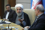 In this photo released by the official website of the office of the Iranian Presidency, President Hassan Rouhani speaks in a meeting with the Health Ministry officials, in Tehran, Iran, Tuesday, June 25, 2019.  Iran on Tuesday sharply criticized new U.S. sanctions targeting the Islamic Republic's supreme leader and other top officials, saying the measures spell the