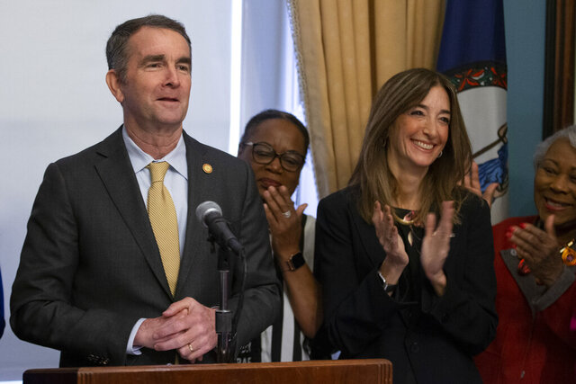 Virginia Gov. Ralph Northam, left, and Virginia House of Delegates speaker-designate, Eileen Filler-Corn, front right, are surrounded by Democratic Legislators as he outlines his legislative agenda at the Capitol in Richmond, Va., Tuesday, Jan. 7, 2020. (AP Photo/Steve Helber)
