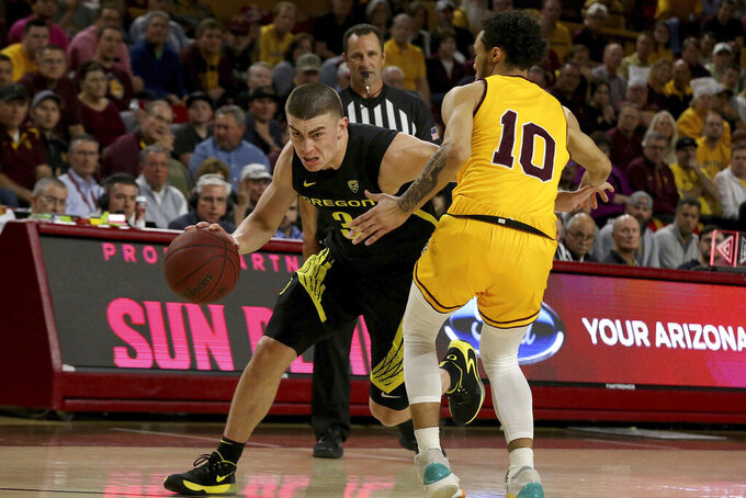 Oregon's Payton Pritchard (3) drives to the basket against Arizona State's Jaelen House (10) during the first half of an NCAA college basketball game Thursday, Feb. 20, 2020, in Tempe, Ariz. (AP Photo/Darryl Webb)