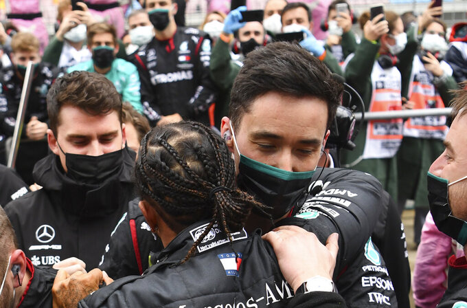Mercedes driver Lewis Hamilton of Britain celebrates with his team after winning the Turkish Formula One Grand Prix at the Istanbul Park circuit racetrack in Istanbul, Sunday, Nov. 15, 2020. (Clive Mason/Pool via AP)