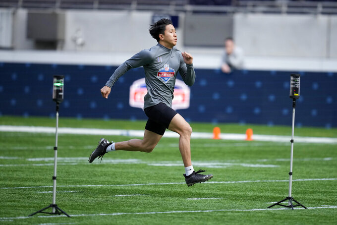Leipzig Kings wide receiver Yoshihito Omi, 11, from Japan takes part in the NFL International Combine at the Tottenham Hotspur Stadium in London, Tuesday, Oct. 12, 2021. International athletes on Tuesday took part in a series of tests in front of NFL evaluators for a potential position in the NFL's International Player Pathway programme. (AP Photo/Matt Dunham)