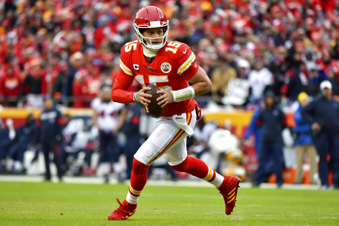 Kansas City Chiefs quarterback Patrick Mahomes (15) scrambles during the first half of an NFL divisional playoff football game against the Houston Texans, in Kansas City, Mo., Sunday, Jan. 12, 2020. (AP Photo/Ed Zurga)