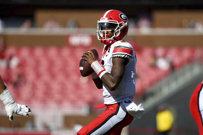 Georgia quarterback D'Wan Mathis drops back to pass against during the first half of the team's NCAA college football game against Arkansas in Fayetteville, Ark., Saturday, Sept. 26, 2020. (AP Photo/Michael Woods)