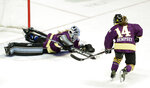 Team Stecklein goalie Nicole Hensley, left, dives on the puck as Jillian Dempsey, right, watches for the rebound in the first period of the NWHL All-Star Hockey Game Sunday, Feb. 10, 2019, in Nashville, Tenn. (AP Photo/Mark Humphrey)
