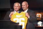 FILE - New Tennessee football coach Jeremy Pruitt, right, receives a personalized jersey from athletic director Phillip Fulmer during his introductory news conference in Knoxville, Tenn., in this Thursday, Dec. 7, 2017, file photo. Tennessee fired Pruitt Monday, Jan. 18, 2021. The university also announced Monday that Phillip Fulmer will retire as athletic director.  (AP Photo/Steve Megargee, FIle)