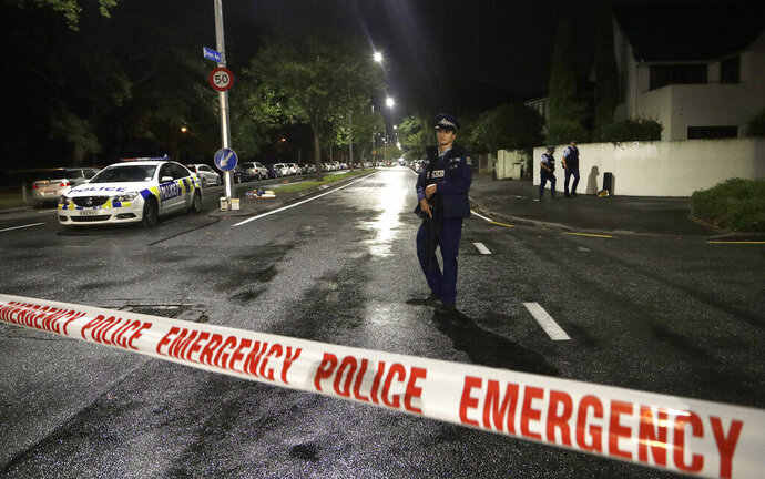 A police officer patrols at a cordon near a mosque in central Christchurch, New Zealand, Friday, March 15, 2019. Multiple people were killed in mass shootings at two mosques full of worshippers attending Friday prayers on what the prime minister called