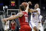 North Carolina State's Braxton Beverly (10) defends against Memphis' Boogie Ellis (5) during the first half of an NCAA college basketball game in the Barclays Classic, Thursday, Nov. 28, 2019, in New York. (AP Photo/Frank Franklin II)