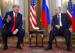 U.S. President Donald Trump, left, gives a statement as Russian President Vladimir Putin looks on at the beginning of a meeting at the Presidential Palace in Helsinki, Finland, Monday, July 16, 2018. (AP Photo/Pablo Martinez Monsivais)