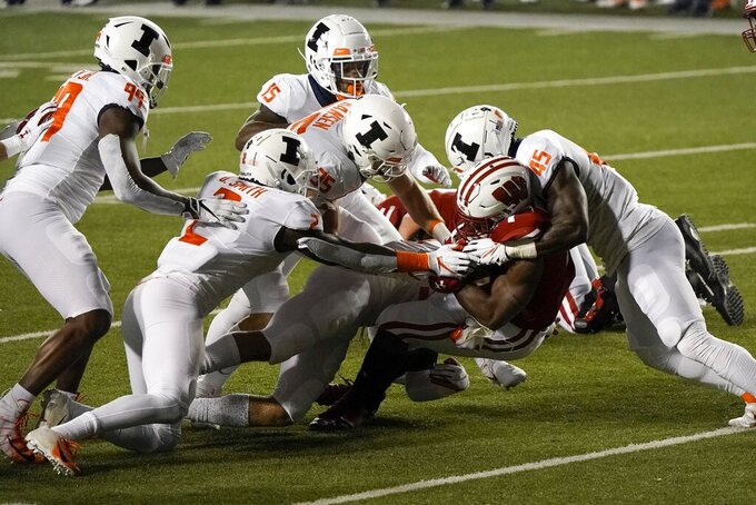Wisconsin running back Nakia Watson is stopped during the first half of an NCAA college football game against Illinois Friday, Oct. 23, 2020, in Madison, Wis. (AP Photo/Morry Gash)