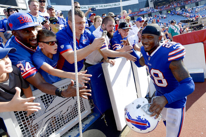 FILE - In this Sept. 24, 2017, file photo, Buffalo Bills cornerback E.J. Gaines runs by fans after an NFL football game against the Denver Broncos, in Orchard Park, N.Y. The Buffalo Bills are providing cornerback E.J. Gaines an opportunity to win back his old starting job by signing the free agent to a one-year contract. Gaines returns to Buffalo after spending last season playing for the Cleveland Browns. (AP Photo/Adrian Kraus, File)