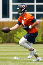 Chicago Bears quarterback Nick Foles works on the field during NFL football practice in Lake Forest, Ill., Wednesday, July 28, 2021. (AP Photo/Nam Y. Huh)