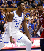 Duke's RJ Barrett (5) celebrates after a score while North Carolina State's Torin Dorn (2) looks on during the second half of an NCAA college basketball game in Durham, N.C., Saturday, Feb. 16, 2019. (AP Photo/Chris Seward)