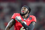 Georgia defensive back Richard LeCounte holds his shoulder during the first half of the team's NCAA college football game against Auburn, Saturday, Oct. 3, 2020, in Athens, Ga. (AP Photo/Brynn Anderson)
