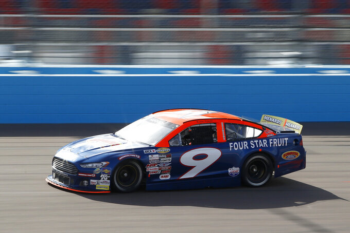 Blaine Perkins (9) races through Turn 4 during the ARCA Series auto race at Phoenix Raceway, Saturday, Nov. 7, 2020, in Avondale, Ariz. (AP Photo/Ralph Freso)