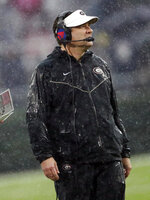 Georgia head coach Kirby Smart watches as rain falls during the first half of an NCAA college football game against Texas A&M, Saturday, Nov. 23, 2019, in Athens, Ga. (AP Photo/John Bazemore)