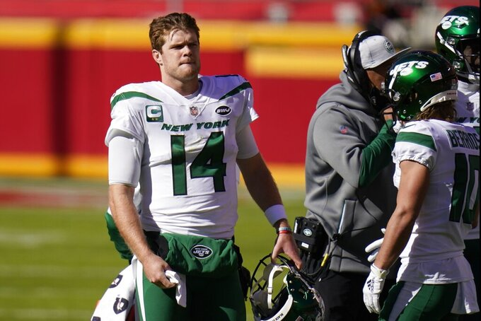 New York Jets quarterback Sam Darnold (14) stands on the sideline in the first half of an NFL football game against the Kansas City Chiefs on Sunday, Nov. 1, 2020, in Kansas City, Mo. (AP Photo/Jeff Roberson)