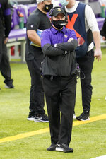 Minnesota Vikings head coach Mike Zimmer stands on the sideline during the first half of an NFL football game against the Jacksonville Jaguars, Sunday, Dec. 6, 2020, in Minneapolis. (AP Photo/Jim Mone)