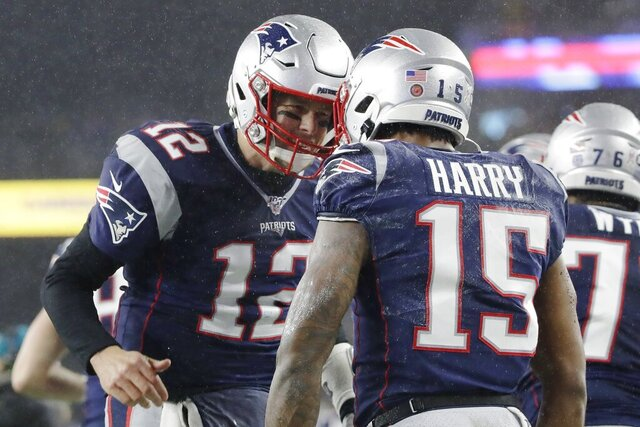 New England Patriots quarterback Tom Brady, left, celebrates his touchdown pass to wide receiver N'Keal Harry, right, in the first half of an NFL football game against the Dallas Cowboys, Sunday, Nov. 24, 2019, in Foxborough, Mass. (AP Photo/Elise Amendola)