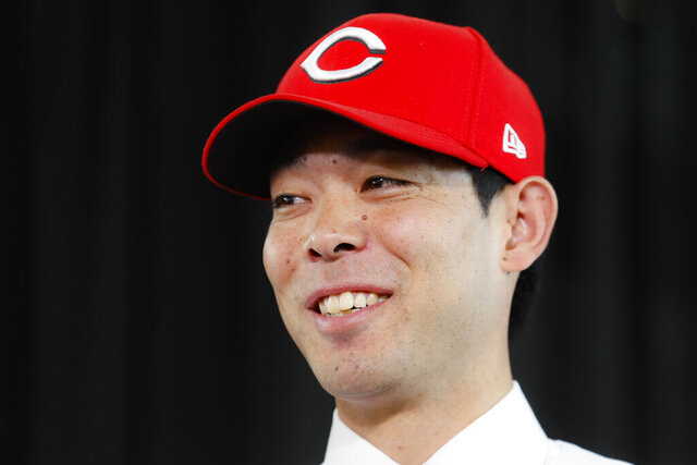 Cincinnati Reds outfielder Shogo Akiyama smiles during a news conference, Wednesday, Jan. 8, 2020, in Cincinnati. Outfielder Shogo Akiyama agreed to a $21 million, three-year deal with the Cincinnati Reds, the only major league team that hasn't had a player born in Japan. The 31-year-old center fielder was a five-time All-Star during his nine seasons with the Seibu Lions in Japan's Pacific League. (AP Photo/John Minchillo)