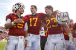 Iowa State quarterback Brock Purdy, left, celebrates with teammates Kyle Kempt (17) and Mike Rose (23) after an NCAA college football game against Texas Tech, Saturday, Oct. 27, 2018, in Ames, Iowa. (AP Photo/Charlie Neibergall)