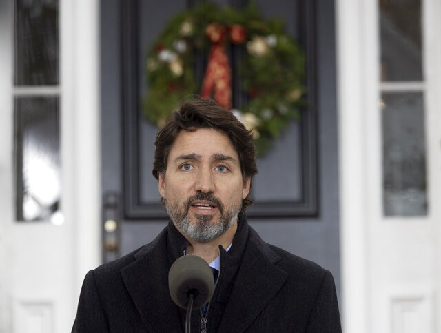 Prime Minister Justin Trudeau speak to the media about the COVID-19 virus outside Rideau Cottage in Ottawa, Friday, Nov. 20, 2020.  (Adrian Wyld/The Canadian Press via AP)