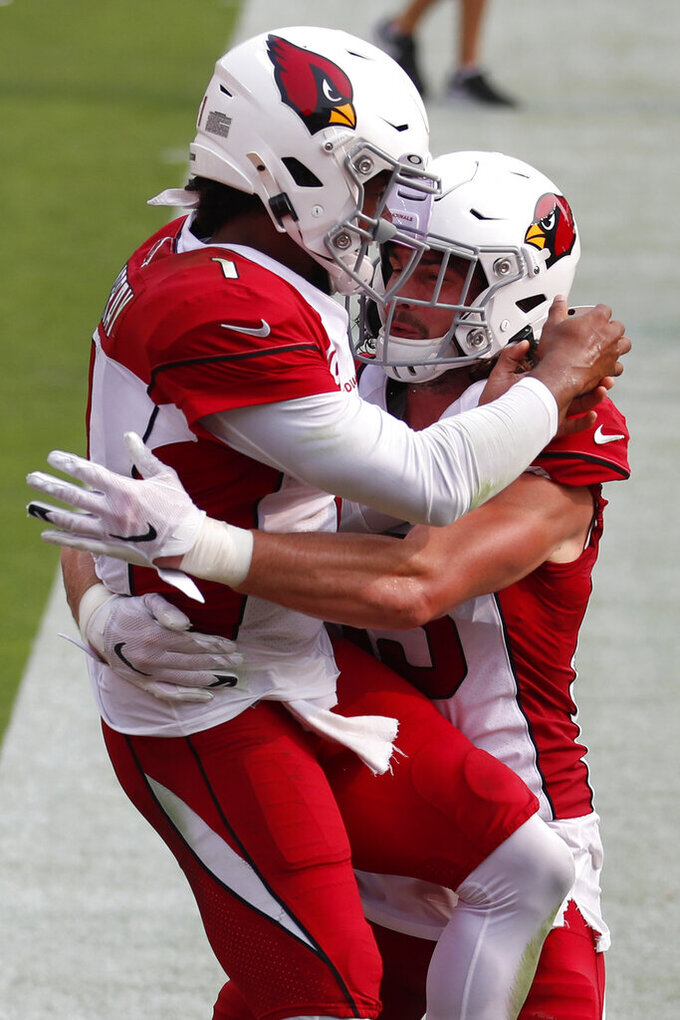 Arizona Cardinals quarterback Kyler Murray, left, celebrates with tight end Dan Arnold after scoring against the San Francisco 49ers during the second half of an NFL football game in Santa Clara, Calif., Sunday, Sept. 13, 2020. (AP Photo/Josie Lepe)