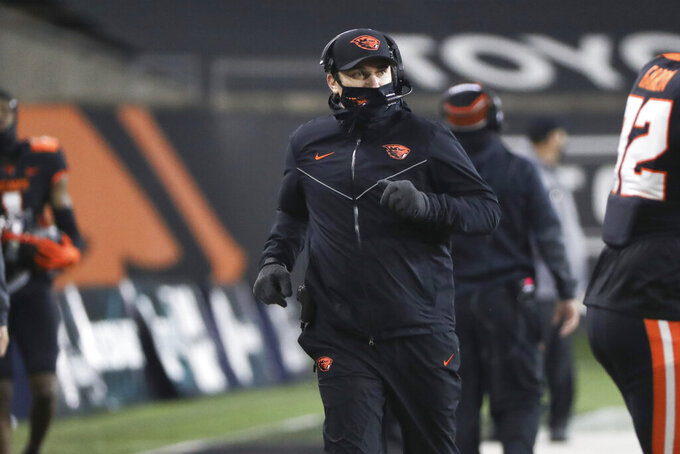 Oregon State head coach Jonathan Smith runs up the sideline during the second half of an NCAA college football game against Stanford in Corvallis, Ore., Saturday, Dec. 12, 2020. Stanford won 27-24. (AP Photo/Amanda Loman)