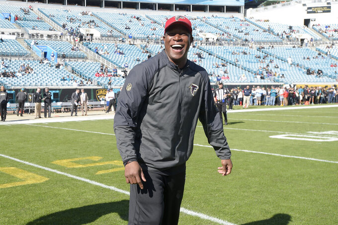 FILE - In this Dec. 20, 2015, file photo, Atlanta Falcons assistant head coach Raheem Morris watches warmups before an NFL football game against the Jacksonville Jaguars in Jacksonville, Fla. The Atlanta Falcons have named defensive coordinator Raheem Morris interim head coach after firing Dan Quinn. Morris is in his sixth season with the Falcons and his first season as defensive coordinator. (AP Photo/Phelan M. Ebenhack, File