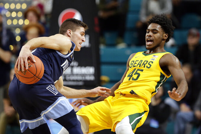 Baylor guard Davion Mitchell (45) guards Villanova guard Collin Gillespie (2) during the first half of an NCAA college basketball championship game at the Myrtle Beach Invitational in Conway, S.C., Sunday, Nov. 24, 2019. (AP Photo/Gerry Broome)