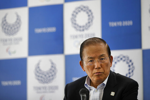 FILE - In this June 11, 2019, file photo, Toshiro Muto, CEO of the 2020 Tokyo Olympics organizing committee, listens to questions from the media during a news conference in Tokyo. As the virus spreads Muto acknowledged he can't guarantee the games can go forward next year. The Olympics were postponed last month with a new opening just under 16 months away. (AP Photo/Jae C. Hong, File)
