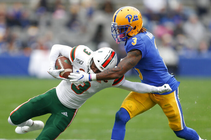 Miami wide receiver Mike Harley, left, tries to get away from Pittsburgh defensive back Damar Hamlin (3) during the first half of an NCAA college football game, Saturday, Oct. 26, 2019, in Pittsburgh. (AP Photo/Keith Srakocic)