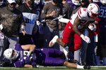 Nebraska running back Dedrick Mills, right, runs over Northwestern linebacker Paddy Fisher during the first half of an NCAA college football game in Evanston, Ill., Saturday, Nov. 7, 2020. (AP Photo/Nam Y. Huh)
