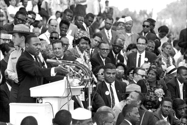 FILE - In this Aug. 28, 1963 file photo, the Rev. Dr. Martin Luther King Jr., head of the Southern Christian Leadership Conference, speaks to thousands during his