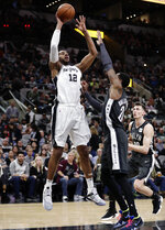 San Antonio Spurs center LaMarcus Aldridge (12) shoots over Brooklyn Nets forward Rondae Hollis-Jefferson (24) during the first half of an NBA basketball game in San Antonio, Thursday, Jan. 31, 2019. (AP Photo/Eric Gay)