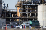 Workers stand in a lot at a LyondellBasell facility in La Porte, Texas Tuesday, July 27, 2021. An explosion Tuesday evening killed two people at the facility and left several others injured. (Mark Mulligan/Houston Chronicle via AP)