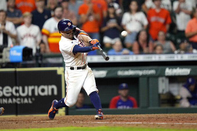 Houston Astros' Jose Altuve hits a game-winning grand slam during the 10th inning of a baseball game against the Texas Rangers Tuesday, June 15, 2021, in Houston. The Astros won 6-3. (AP Photo/David J. Phillip)