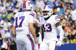Buffalo Bills wide receiver Gabriel Davis (13) celebrates with quarterback Josh Allen (17) after his touchdown during the first half of a preseason NFL football game against the Green Bay Packers, Saturday, Aug. 28, 2021, in Orchard Park, N.Y. (AP Photo/Jeffrey T. Barnes)