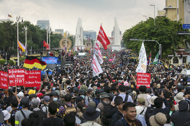 Thousands of pro-democracy protesters march out from the Democracy Monument to the Government House in Bangkok, Thailand, Wednesday, Oct. 14, 2020. Thousands of anti-government protesters gathered Wednesday for a rally at Bangkok's Democracy Monument being held on the anniversary of a 1973 popular uprising that led to the ousting of a military dictatorship, amid a heavy police presence and fear of clashes with political opponents. (AP Photo/Wason Wanichakorn)